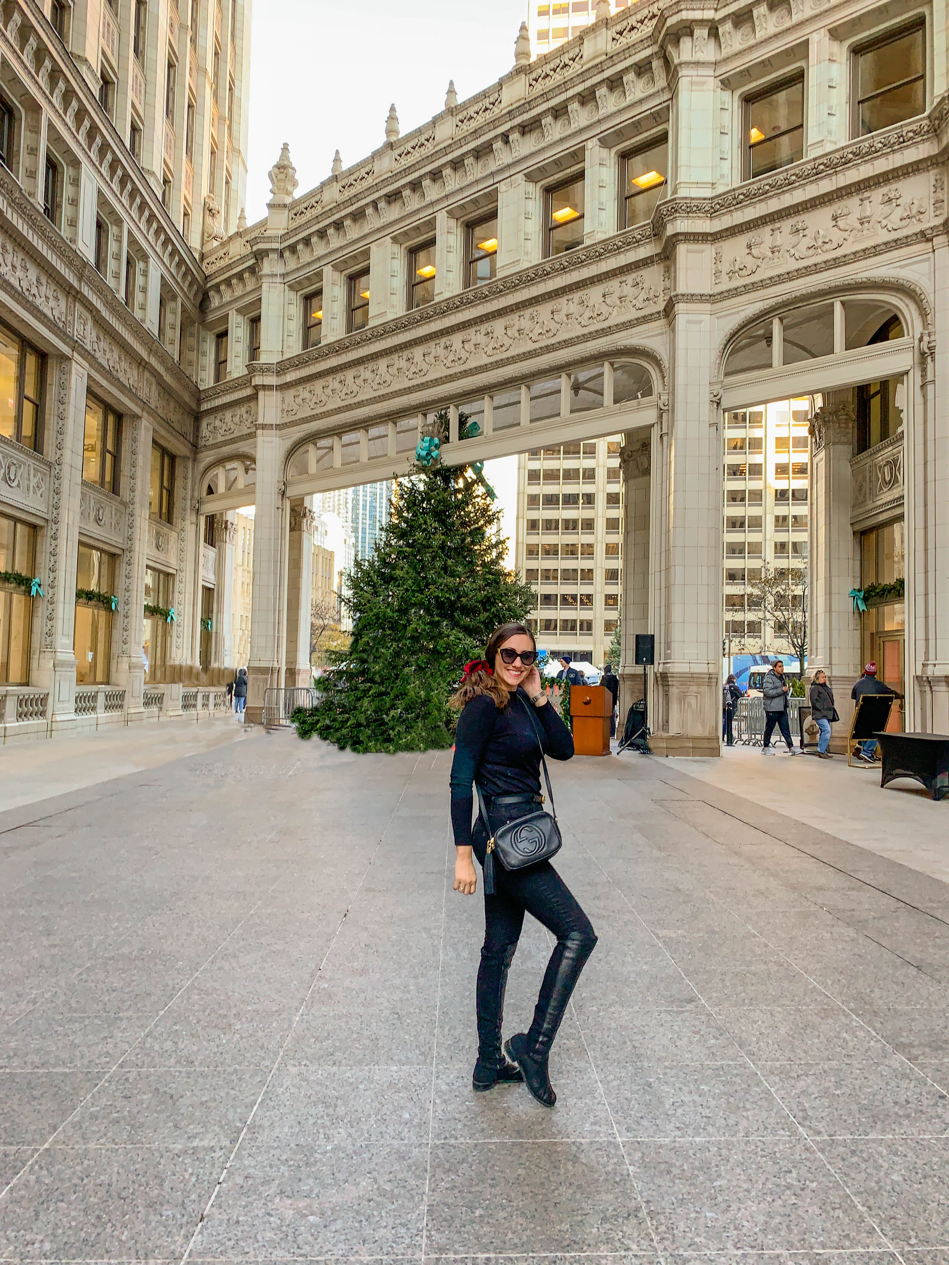 girl in front of wrigley building chicago