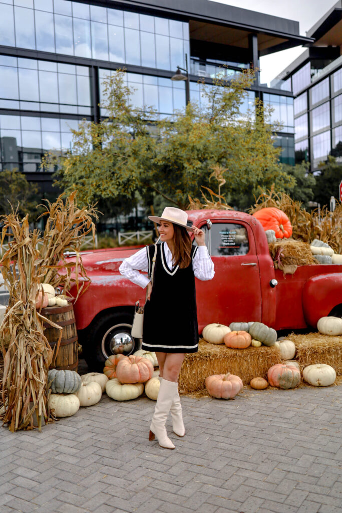 girl in front of fall decor in one paseo del mar